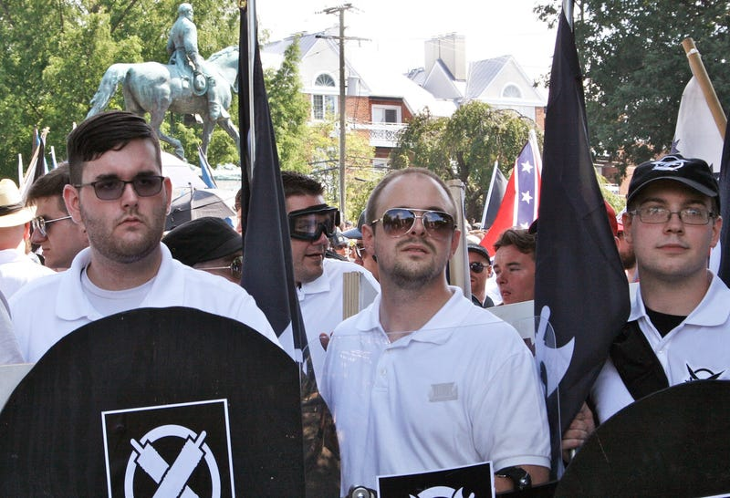 Saturday, Aug. 12, 2017, James Alex Fields Jr., left, holds a black shield in Charlottesville, Va., where a white supremacist rally took place.