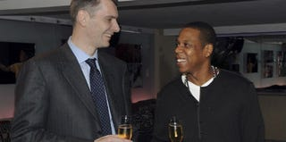Brooklyn Nets owner Mikhail Prokhorov meets with Jay-Z. (Larry Busacca/Getty Images)