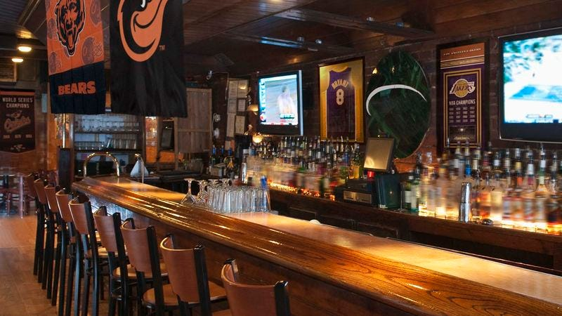 Illustration for article titled Backstory Probably Explains Why Sports Bar Has Orioles, Lakers, Bears Flags