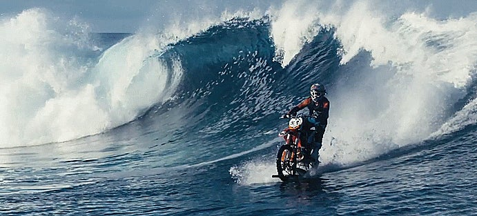 Holy Cojones This Guy Is Surfing In The Ocean On A Dirt Bike