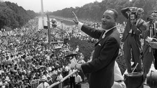 Martin Luther King Jr. waving to supporters from the steps of the Lincoln Memorial during the March on Washington Aug. 28, 1963AFP/Getty Images