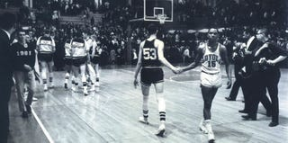 Mississippi State's Stan Brinker (53) and Loyola's Jerry Harkness (15)(Loyola University Chicago)