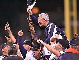 Illustration for article titled Detroit Tigers Carry Jim Leyland To Bathroom