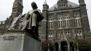 A statue of John Carroll, founder of Georgetown University, sits before Healy Hall on the school's campus Aug. 15, 2006, in Washington, D.C. Georgetown University was founded in 1789 and is the oldest Catholic and Jesuit university in the U.S. Alex Wong/Getty Images