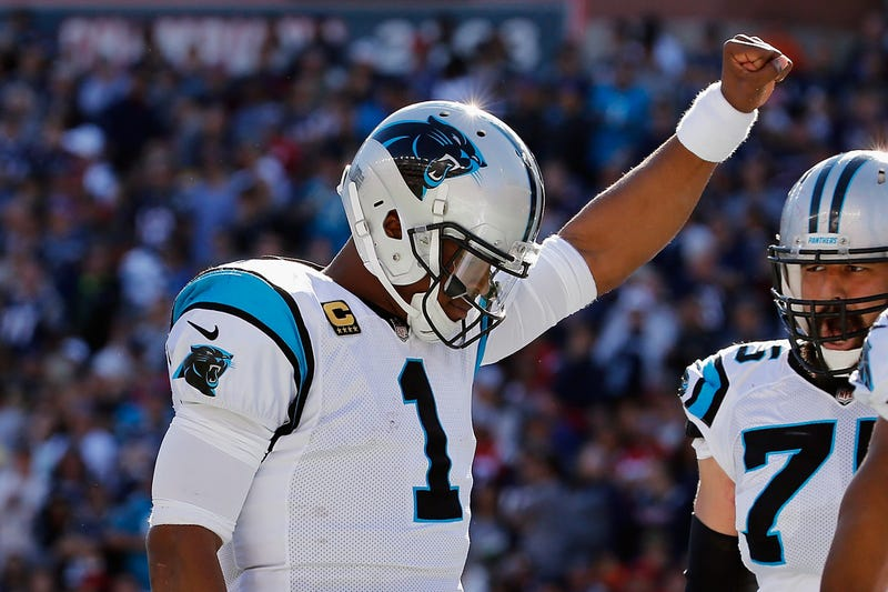 Cam Newton, No. 1 of the Carolina Panthers, raises his fist in the end zone after scoring a touchdown during the fourth quarter against the New England Patriots at Gillette Stadium in Foxboro, Mass.,  on Oct. 1, 2017. (Jim Rogash/Getty Images)