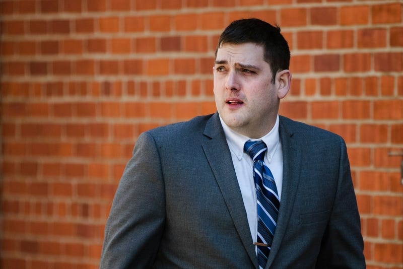 Former East Pittsburgh police officer Michael Rosfeld, charged with homicide in the shooting death of Antwon Rose II, walks to the Dauphin County Courthouse in Harrisburg, Pa., Tuesday, March 12, 2019. (AP Photo/Matt Rourke)