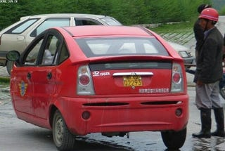 Illustration for article titled Chinese Car Maker Knocks-Off Prius, Leaves Off Wheel, May Be Electric