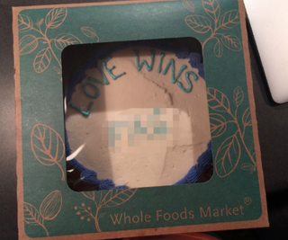"""A photo of the cake a Texas pastor, Jordan Brown, says he received from a Whole Foods. Brown says he asked that the cake have the words """"Love Wins"""" written on it, but charges that the cake he received included a homophobic slur: """"Love Wins [F—].""""KEYE Screenshot"""
