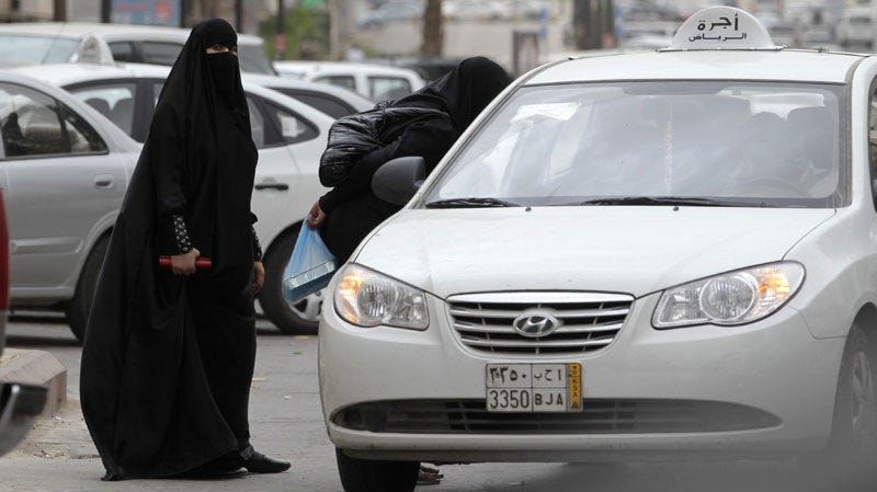 Saudi women board a taxi. (AP)