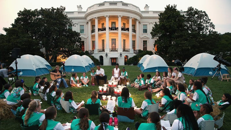Girl Scouts from around the country at a camp out on the South Lawn of the White House with Barack and Michelle Obama. Photo via Getty.