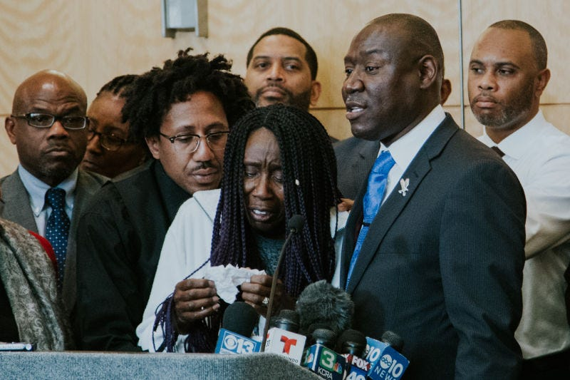 Stephon Clark's grandmother Sequita Thompson delivers a tearful speech at a news conference in Sacramento, Calif.'s City Hall on March 26, 2018. Clark's uncle Kurtis Gordon (left) and family attorney Benjamin Crump (right) stand with her at the podium.