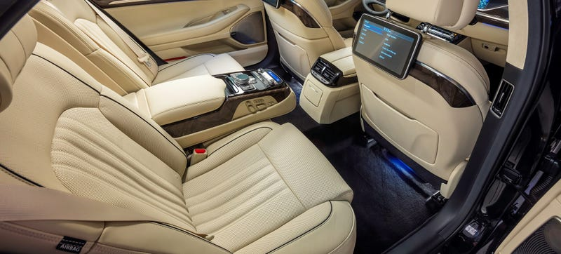 Illustration for article titled The Back Seats Of The Genesis G90 Are Thrones