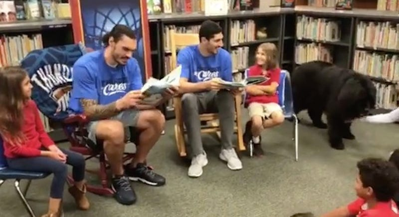 Illustration for article titled Steven Adams And Enes Kanter Met Some Dogs And Some Kids