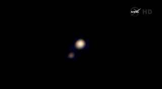 Illustration for article titled New Horizons' First Color Photo of Pluto Is One Awe-Inspiring Blur
