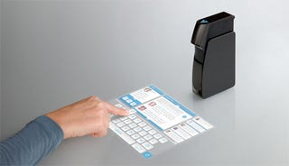 Illustration for article titled Pico Projector From Light Blue Optics Throws Up a 10-inch Touchscreen Laser Projection
