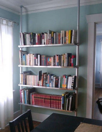 diy compression bookcases provide airy and wall friendly shelving. Black Bedroom Furniture Sets. Home Design Ideas