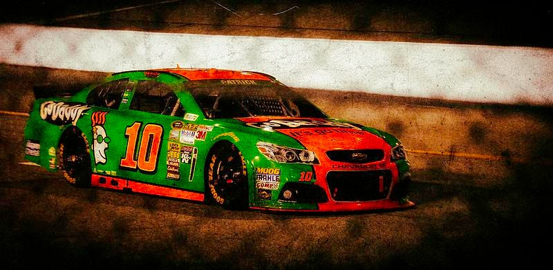 Danica Patrick racing in the Monster Energy NASCAR Cup Series. Few memorable results followed her highly discussed switch to stock cars. Used under CC BY 2.0.