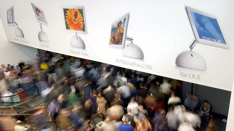 Attendees enter the Macworld Expo in San Francisco on January 8, 2002.