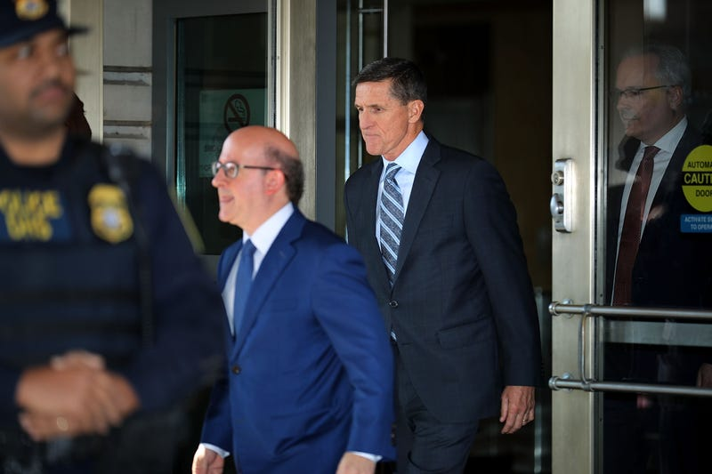Michael Flynn (center, right), former national security adviser  to President Donald Trump, leaves after his plea hearing at the Prettyman Federal Courthouse on Dec. 1, 2017, in Washington, D.C. (Chip Somodevilla/Getty Images)