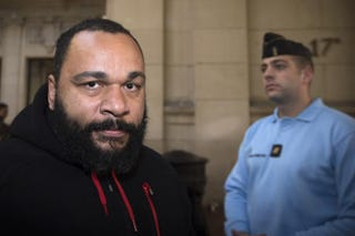 French humorist Dieudonné M'bala M'bala arrives for a trial at the Paris courthouse Dec. 13, 2013, on the charges of defamation, insults, incentive to hate and discrimination.JOEL SAGET/AFP/Getty Images