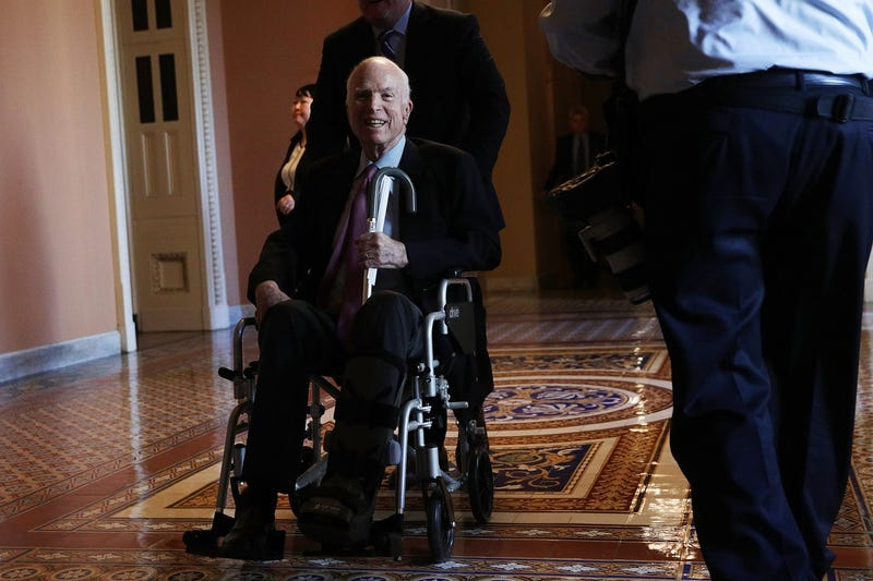 Sen. John McCain (R-Ariz.) passes by on a wheelchair in a hallway at the Capitol on Dec. 1, 2017, in Washington, D.C.