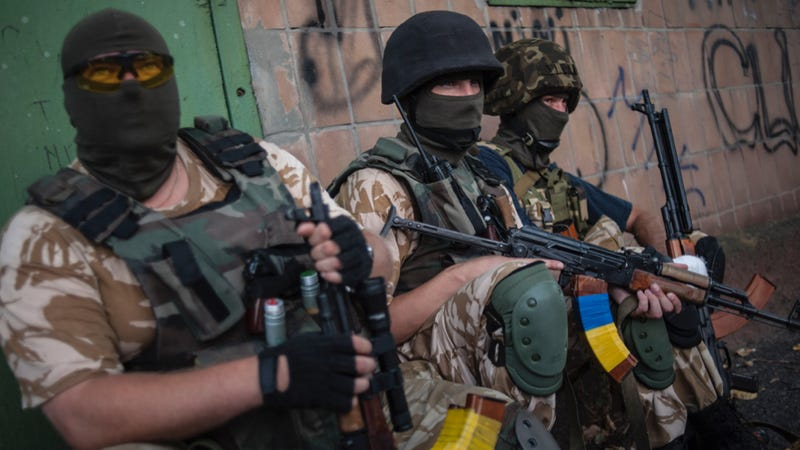 Ukrainian government soldiers take a breather in eastern Ukraine during a lull in the fighting in 2014. Photo credit: AP