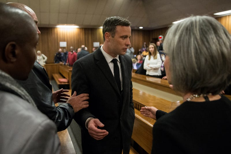 Olympic athlete Oscar Pistorius speaks with relatives after sentencing at the High Court in Pretoria, South Africa, on July 6, 2016.Marco Longari-Pool/Getty Images
