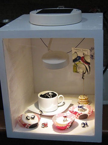 with just some wood plexiglass and a 20 lamp from ikea you can create a lit display case that can be positioned the electric cord