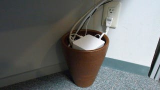 Illustration for article titled Use a Flower Pot to Tame Your Cable Clutter