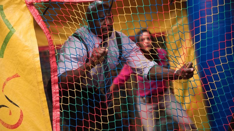 Terry Crews in a bounce house (left), Melissa Fumero in a bounce house