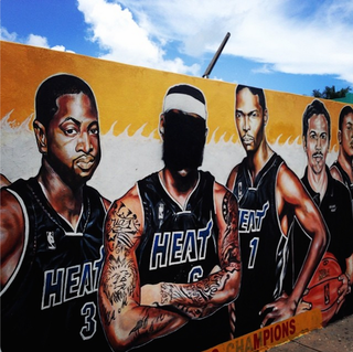 Illustration for article titled Someone Already Defaced LeBron's Face On A Miami Heat Mural