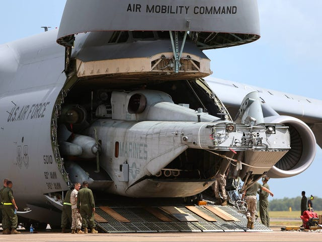 Ini Shot Of A C-5 Galaxy Regurgitating A CH-53E Super Stallion Is Crazy