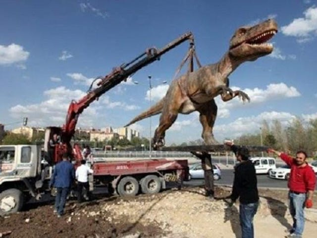 What's Better Than A Giant Gundam Statue? A Dinosaur, Apparently.