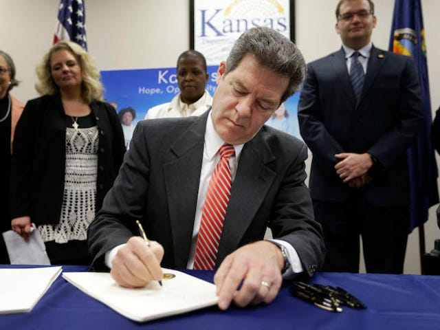 Waitress Tells Governor Sam Brownback Where He Can Leave His Tip