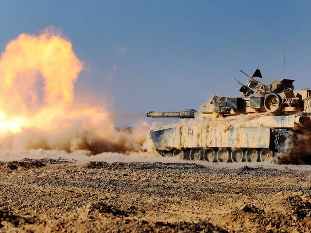 Kick ass photo of a M1 Abrams tank blasting its cannon like a fire beast