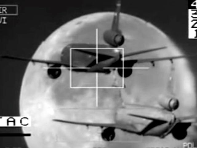Incredible video of an air tanker refueling a tanker against a full moon