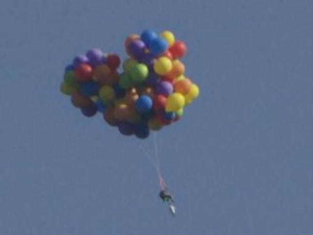 Hero Man Flies Balloon Chair Through the Sky