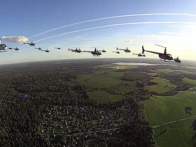Watch 25 Robinson Helicopters Fly In Formation Over Russia