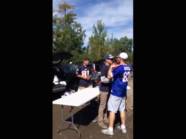 Bills Fan Uses Teamwork To Slam Patriots Fan Through Table