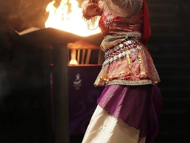 Gorgeously Bejeweled Dancer Fans Flames