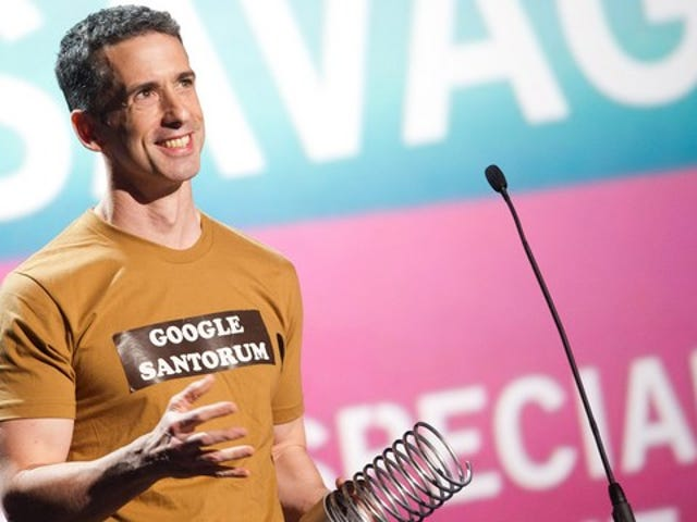 Dan Savage Cordially Invites Herman Cain to Prove That Being Gay is a Choice