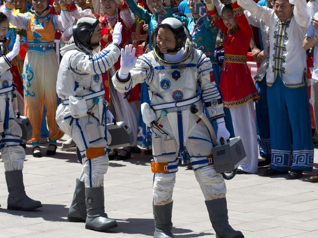 China launches three astronauts to its prototype space station