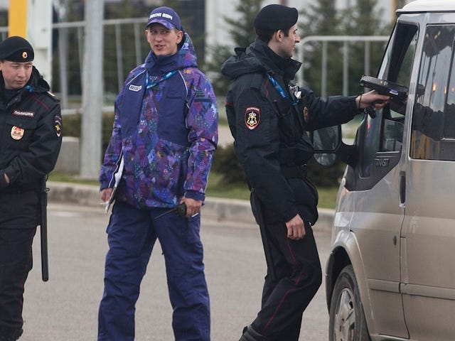 Sochi Makes Terrifying Police Less Scary With Fab Purple Uniforms
