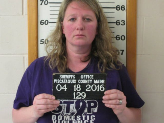 Woman Wearing 'Stop Domestic Violence' Shirt Charged with Menacing Her Husband With a Gun