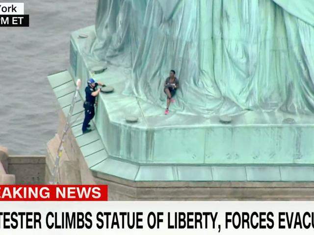 A Black Woman in Handcuffs For Climbing The Statue of Liberty on Independence Day is a Perfect Metaphor For America