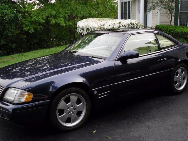 Pour 10 950 $, pourriez-vous compléter cette 1999 Mercedes Benz SL500 avec un toit panoramique?