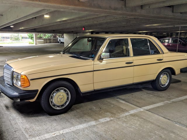 Custard is a lovely color for an old Benz