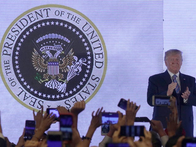 Trump Gives Speech in Front of Altered Presidential Seal Featuring Golf Clubs and '45 Is a Puppet'
