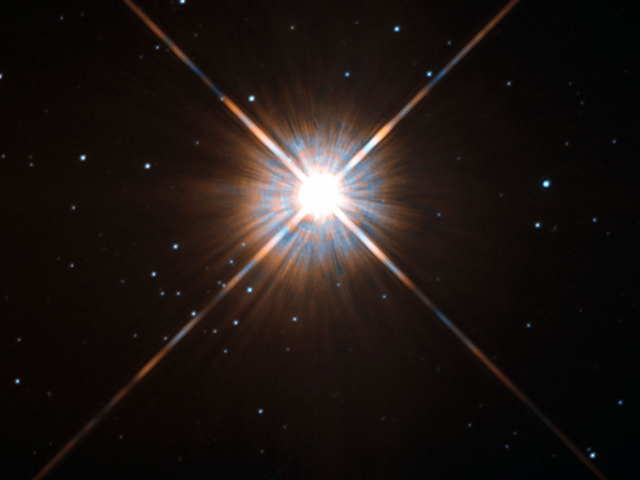 Astronomers See Glimmers of a Second World Circling the Nearest Star to the Sun