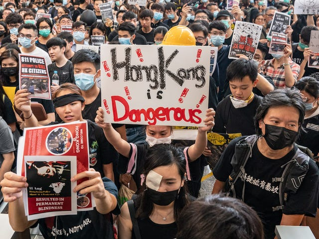 Hong Kong Cancels All Flights as Thousands of Pro-Democracy Protesters Occupy Airport